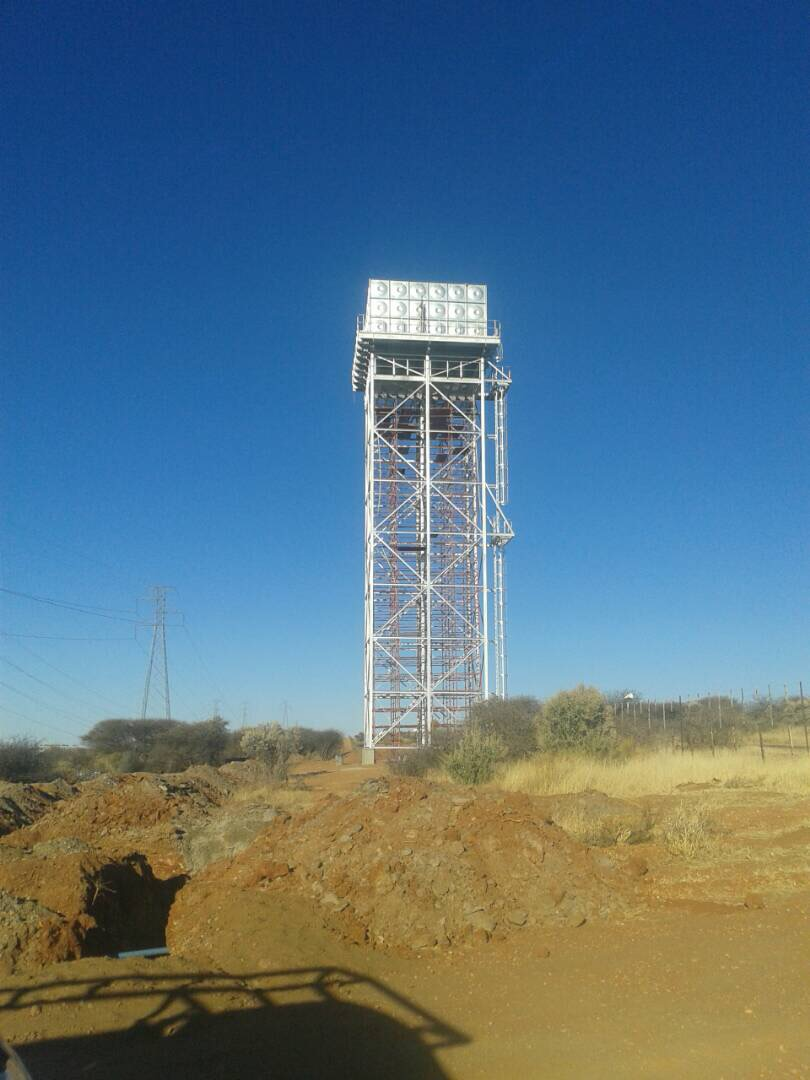 The final product, a 300,000 liter elevated water storage tank installed on a 25m tower.